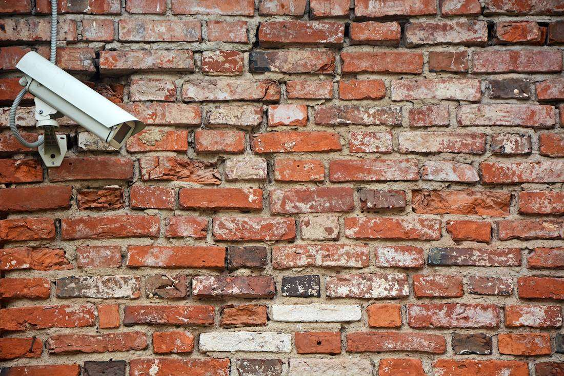 CCTV camera pointing at wall