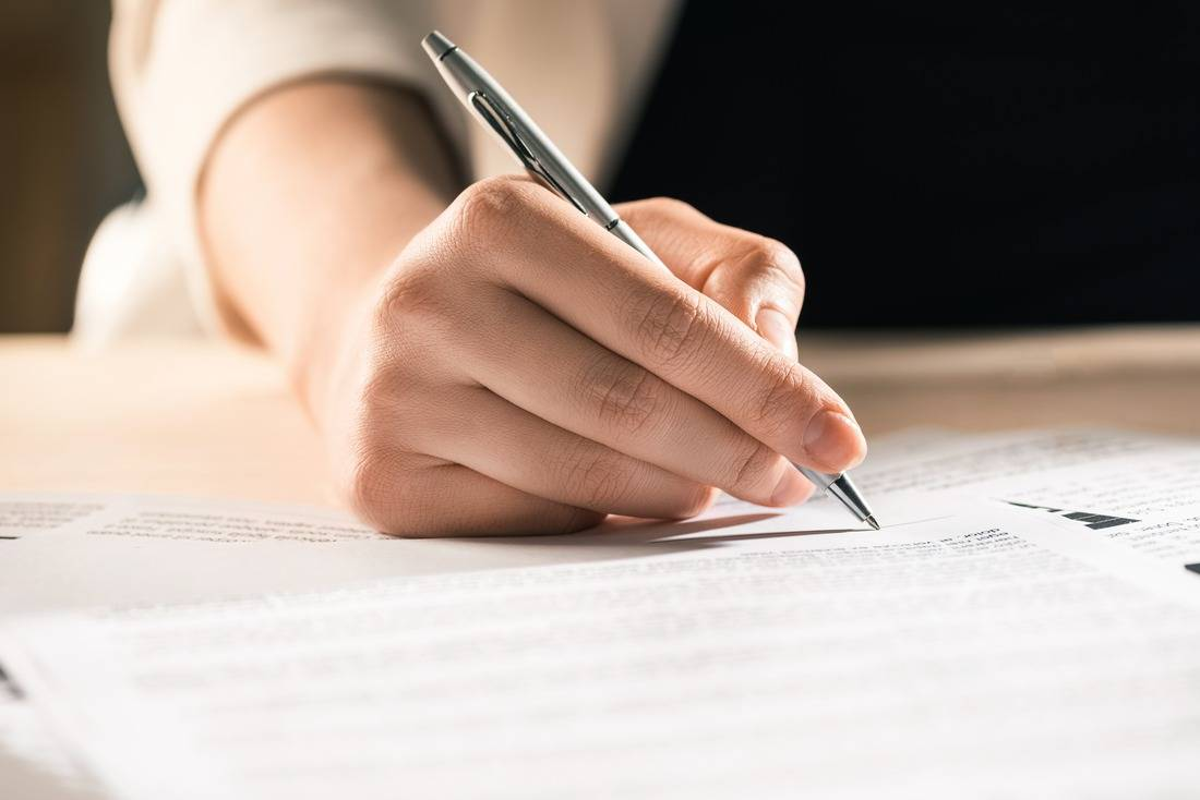 Woman signing consent paper